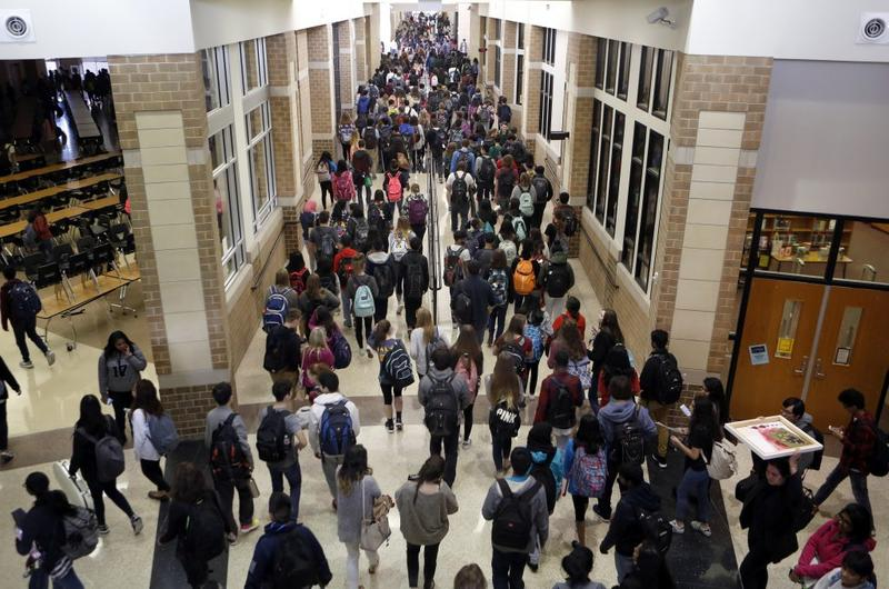 Students crowd the hallway after the last bell rings at Liberty High School in Frisco, Texas, in February 2017.