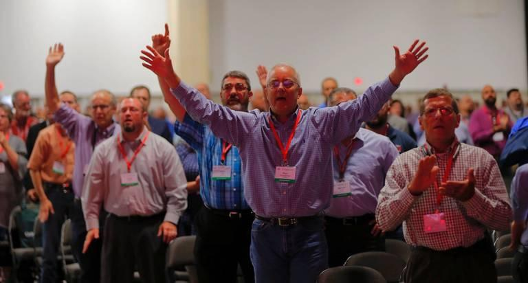 Messengers worship God during singing after a sermon by the Rev. Steve Gaines, the current president, at the 2018 annual meeting of the Southern Baptist Convention in Dallas on Tuesday, June 12, 2018.