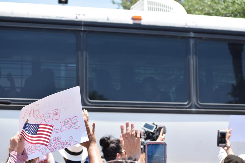 Protesters crowd a bus carrying immigrant children in McAllen, Texas, on June 23, 2018.