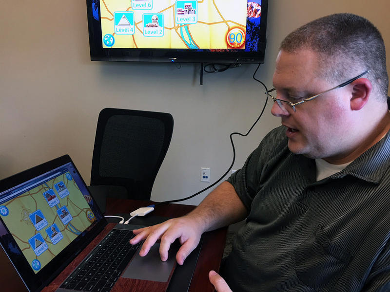 Southern Methodist University professor Corey Clark says by making the app his team created a game, it helps reduce the stigma of illiteracy.