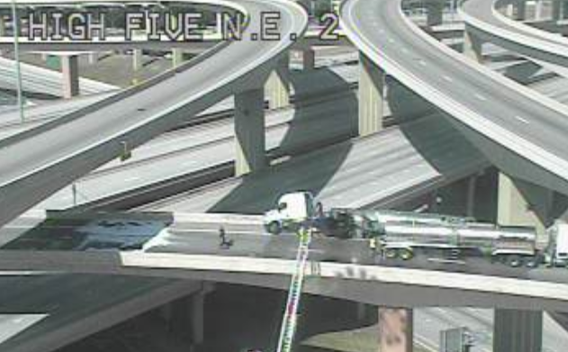 A truck rolled over and spilled its contents on the High Five interchange early Thursday morning, prompting a hazardous materials cleanup that could last for hours, authorities say. This image from TxDOT's traffic cameras was taken shortly before 10 a.m.