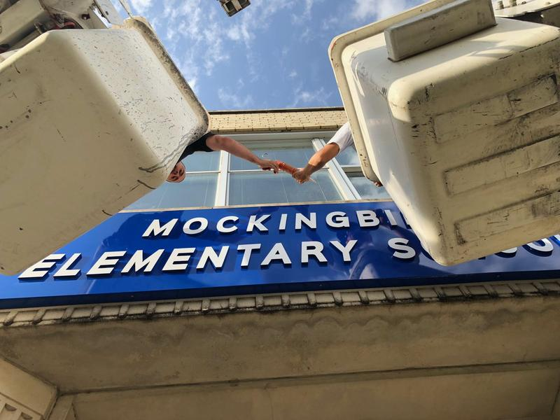 Workers on Monday installed a new sign reflecting a new name for Stonewall Jackson Elementary: Mockingbird Elementary.