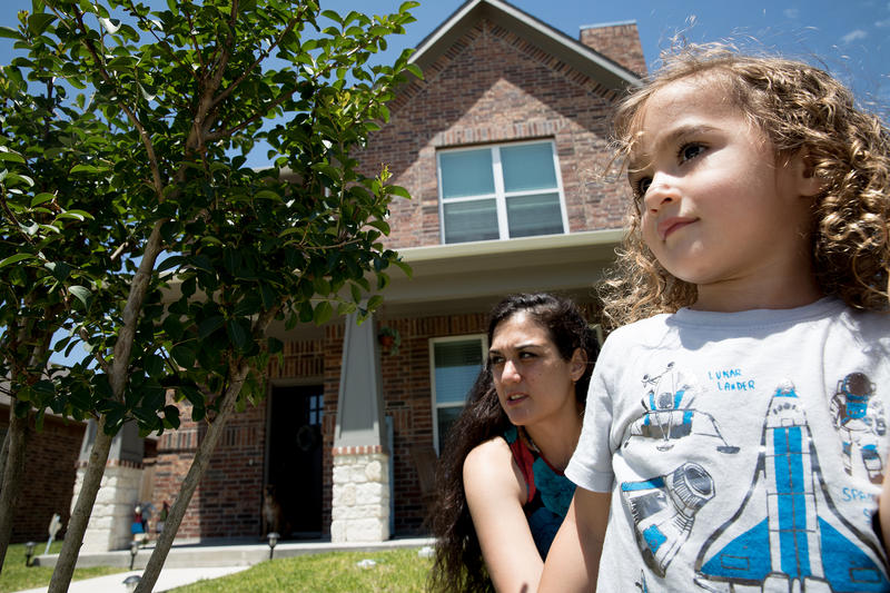 Lindsay Diaz and her 3-year-old son, Arian, outside their new home in Rowlett, Texas, in May 2018.