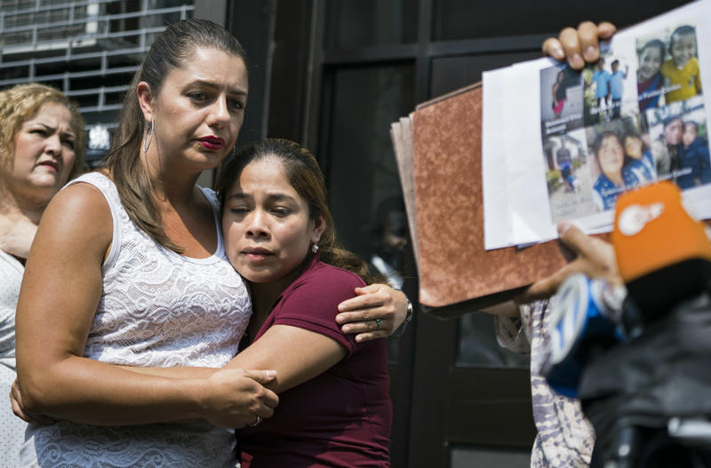 Yeni Gonzalez, a Guatemalan mother who was separated from her three children at the U.S.-Mexico border, center, is embraced by volunteer Janey Pearl of Arizona during a news conference Tuesday, July 3, 2018 in New York.
