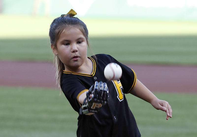 Hailey Dawson, 8, of Las Vegas throws out the ceremonial first pitch at PNC Park in Pittsburgh on July 9, 2018. She's wearing a 3D-printed prosthetic designed and built at the University of Nevada Las Vegas.