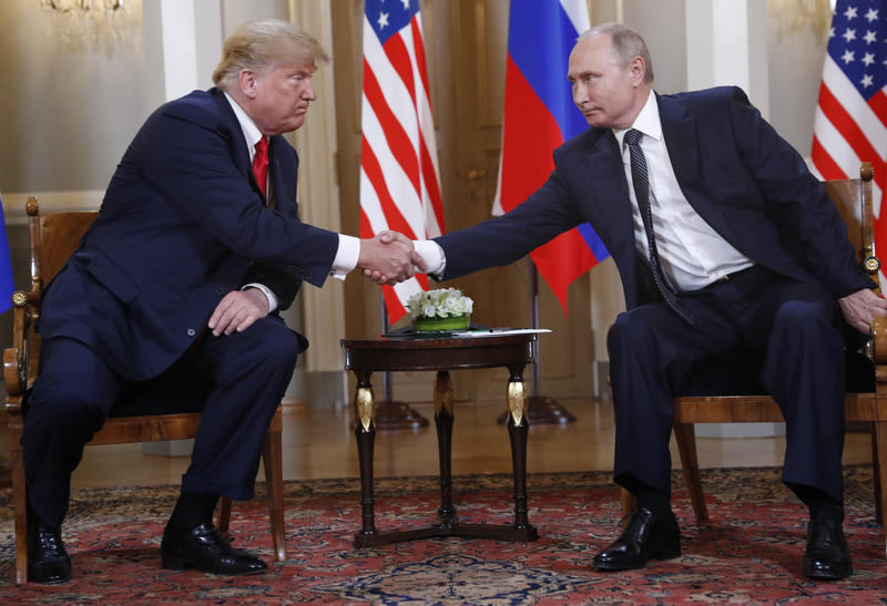 U.S. President Donald Trump, left, and Russian President Vladimir Putin shake hand at the beginning of a meeting at the Presidential Palace in Helsinki, Finland, July 16, 2018.