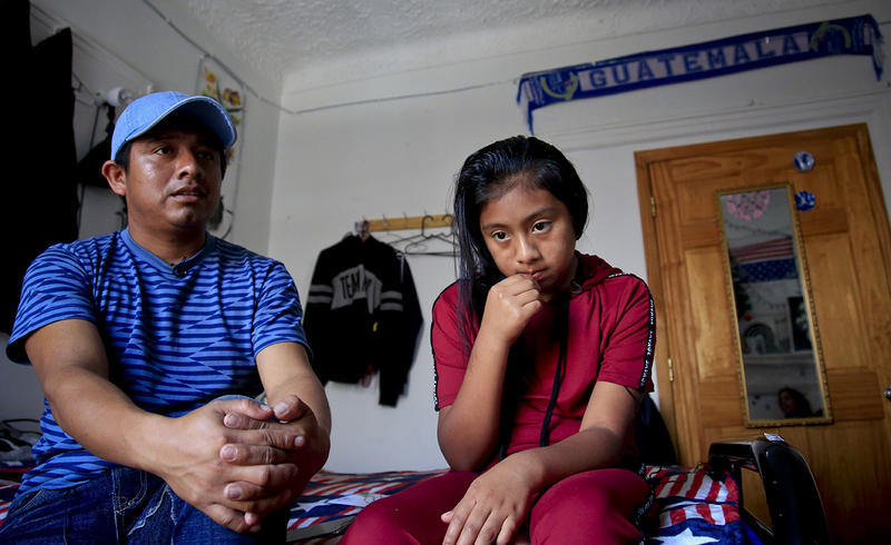 Manuel Marcelino Tzah, left, and his daughter Manuela Adriana, 11, sit inside their apartment after her release from immigrant detention, on July 18 in Brooklyn. The Guatemalan asylum seekers were separated May 15 after they crossed the border into Texas.