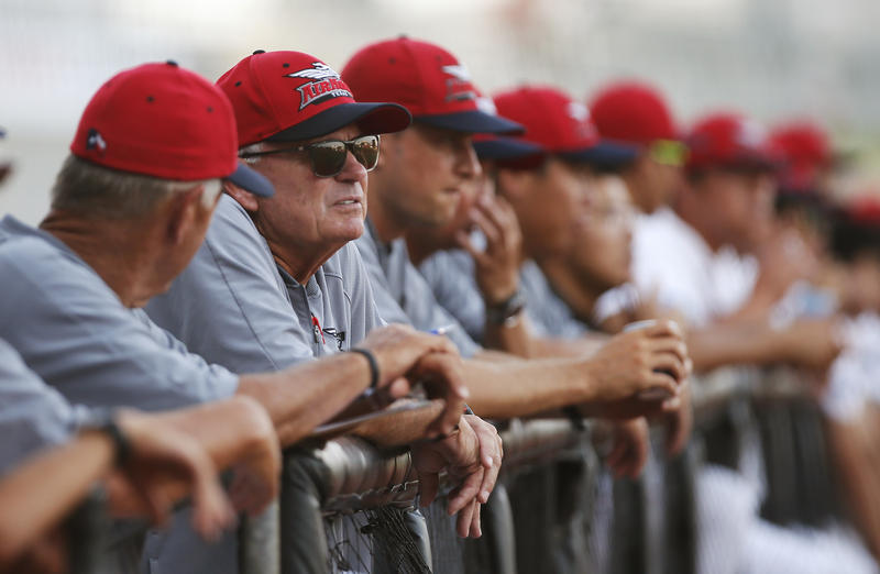Texas AirHogs manager John McLaren, second from left, on July 18 in Grand Prairie. The small ballpark is home this summer for the Chinese national baseball team under an unprecedented setup. McLaren has been involved with the Chinese team since 2011.