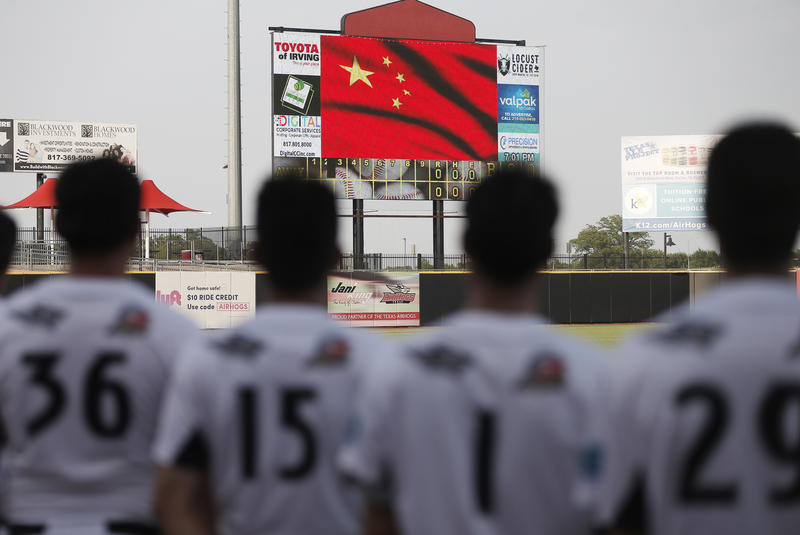 Texas AirHogs' Na Chuang (36), Song Yunqi (15), Yang Yanyong (1) and Yang Jin (29), all of China, stand for the playing of the Chinese national anthem before an American Association of Independent Professional Baseball game, on July 18 in Grand Prairie.