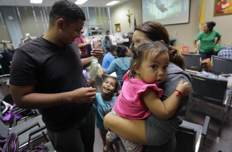 Honduras immigrants seeking asylum, Carlos Fuentes Maldonado, left, stands with his wife, Jennifer Maradiaga, and daughters Mia, 1, and Britany, 4, after they were reunited July 23, 2018, in San Antonio.