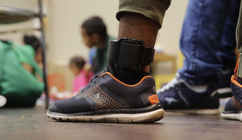 Honduras immigrant seeking asylum Carlos Fuentes Maldonado, who was released and reunited with his family, wears an ankle monitor as he waits at a Catholic Charities facility, Monday, July 23, 2018, in San Antonio.