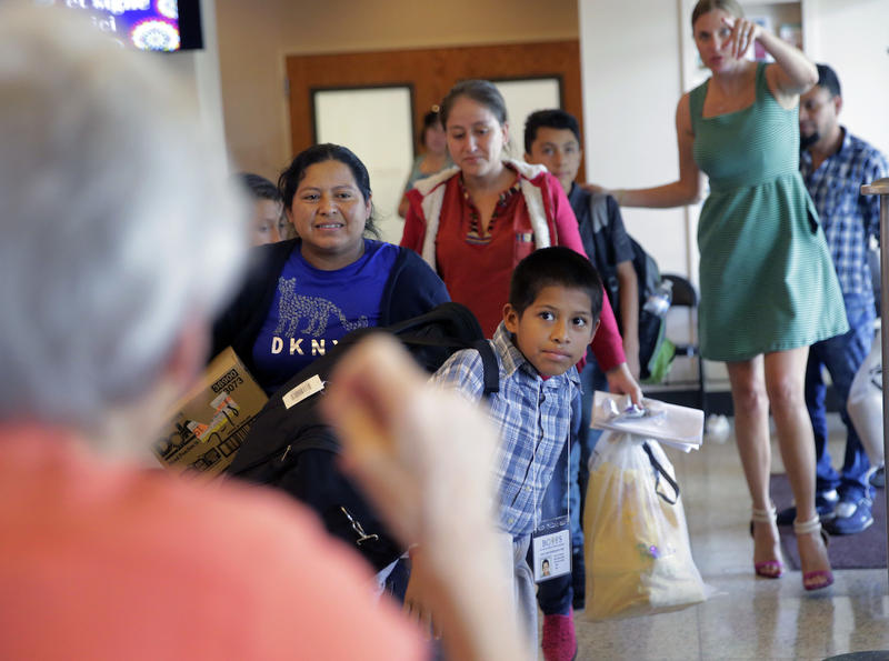 Immigrants recently released and reunited with family arrive at a Catholic Charities facility July 23, 2018, in San Antonio.