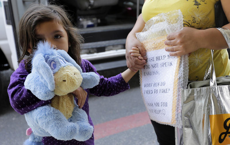 Immigrants recently released and reunited with family arrive at a Catholic Charities facility on July 23, 2018, in San Antonio. As the government faces a deadline to reunite hundreds of families, it is shifting the responsibility to faith-based groups.
