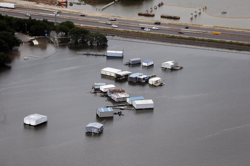 A swollen Lake Lewisville forced boat house to break free from their moorings, Friday, May 29, 2015.