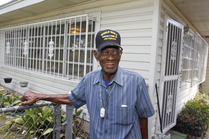 Richard Overton, photographed in 2013 at the age of 107, surveys his the backyard of his home in Austin, Texas.