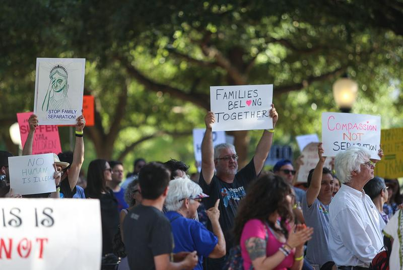 Protesters call for immigrant families to be kept together at a rally in Austin on Thursday, June 14, 2018.