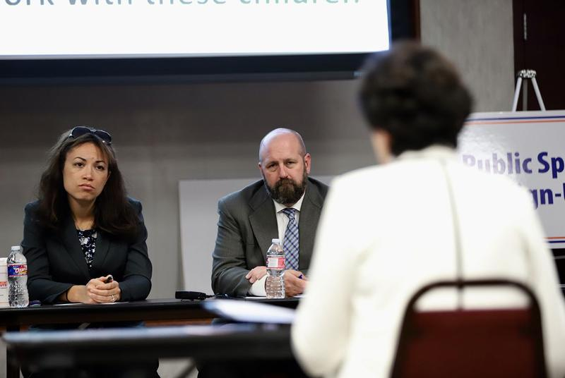 Texas Education Agency officials Penny Schwinn and Justin Porter listen to testimony at a hearing on special education in Richardson on April 16, 2018.