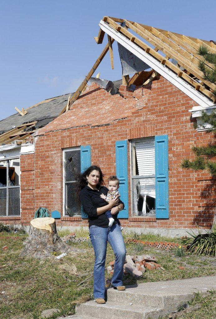 Lindsay Diaz and then 7-month-old Arian photographed in February 2016 in front of their  duplex that was damaged by a tornado, and later, accidentally demolished.