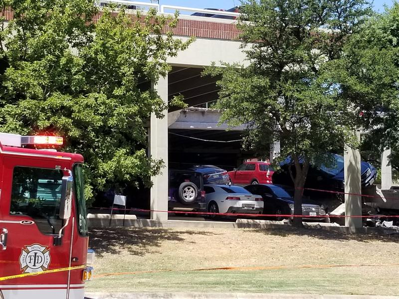 About 20 cars were affected when a parking garage paritally collapsed in Irving.