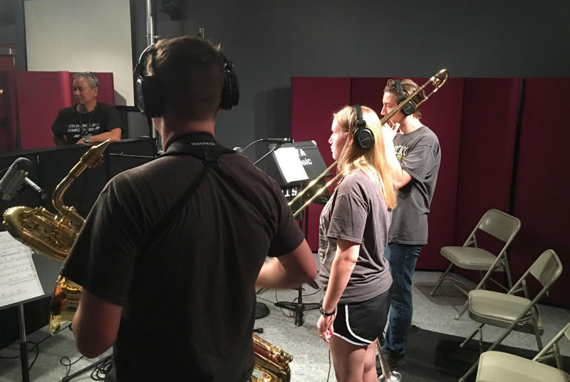 UT-Arlington jazz camp musicians played and recorded in a studio as part of the audio production camp.