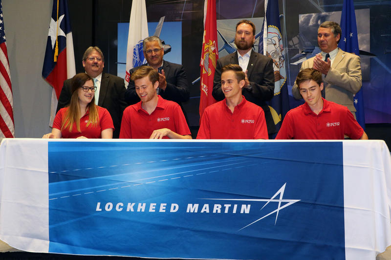 From left to right: Amy Hughes, Benson Phillips, Abdallah Shishani and Austin Smith, all Lockheed Martin interns and former Arlington ISD students, signed contract agreements with the defense company at the Fort Worth, Texas, campus in July.
