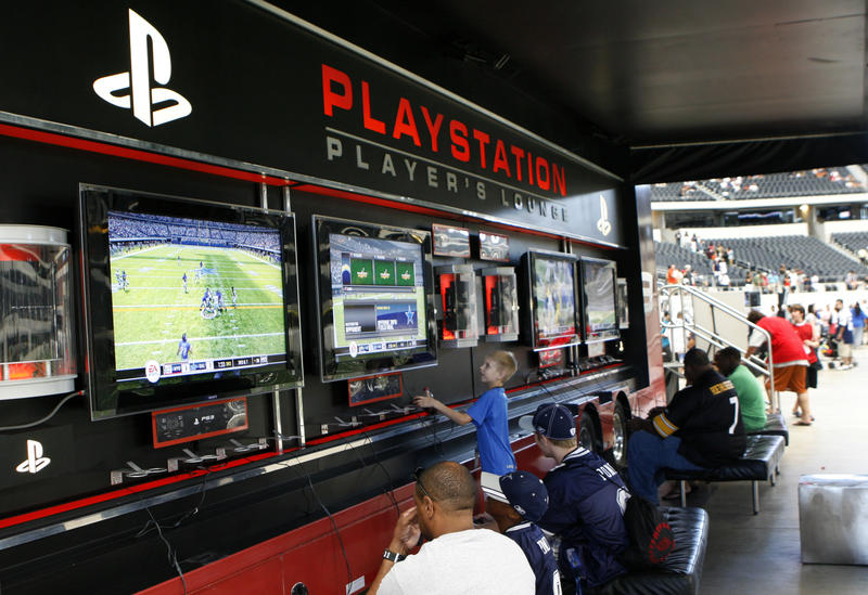 Gamers compete during the Sony PlayStation Madden Tournament at Cowboys Stadium in Arlington, Aug. 8, 2009.