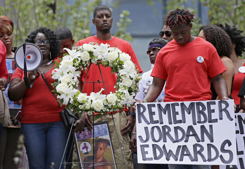 Slain teen Jordan Edwards' mother Charmaine Edwards, left, speaks to supporters with son Vidal Allen, right, and husband Odell Edwards during a protest outside the courthouse in Dallas in May 2017.