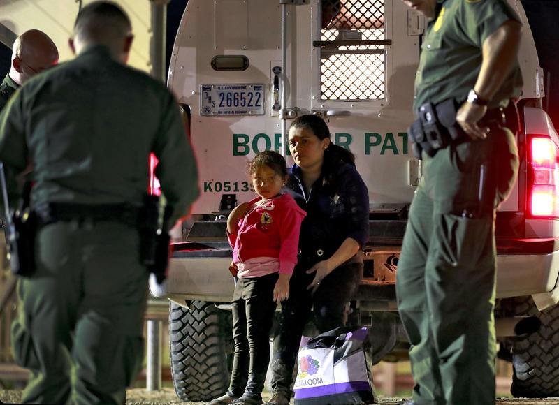 A mother and 5-year-old daughter from Honduras are detained by U.S. Customs and Border Patrol agents in July.