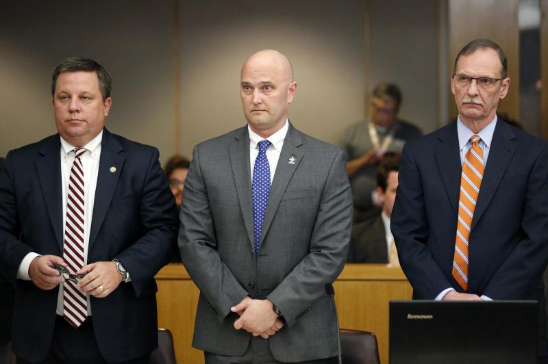 Fired Balch Springs police officer Roy Oliver, center, and his attorneys Miles Brissette, left, and Bob Gill stand before the reading of the verdict during Oliver's trial at the Frank Crowley Courts Building in Dallas on Aug. 28, 2018.
