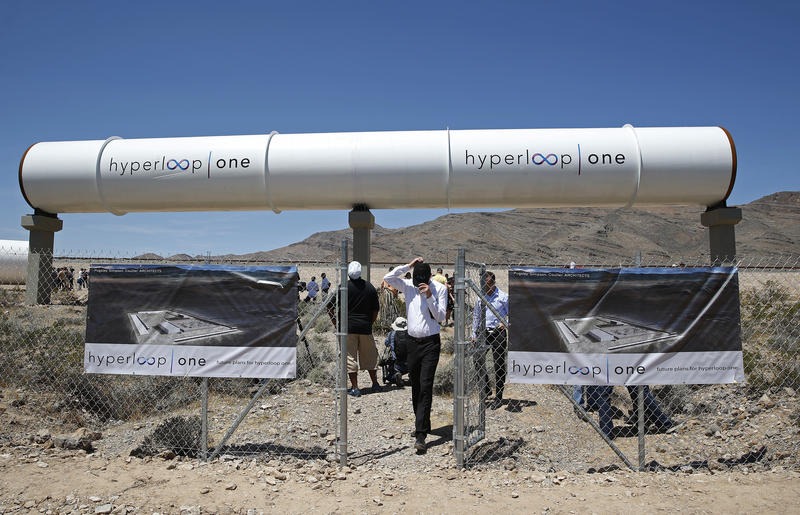 People tour the site after a test of a Hyperloop One propulsion system. The startup company opened its test site outside of Las Vegas for the first public demonstration of technology for a super-speed, tube based transportation system.
