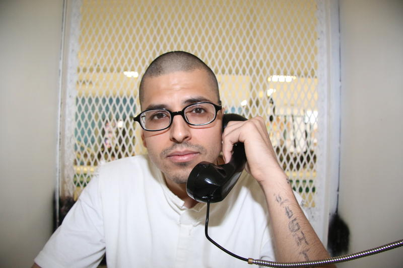 In this Aug. 5, 2015 photo, Daniel Lee Lopez, 27, speaks from a visiting cage outside death row at the Texas Department of Criminal Justice Polunsky Unit near Livingston, Texas.