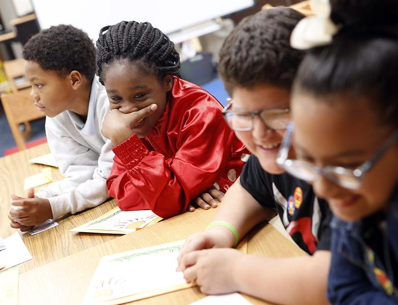 """Fourth-graders in a writing camp at Mitchell Boulevard Elementary School in Fort Worth ISD in April. Mitchell Boulevard is one of the schools that came off the """"improvement required"""" list this year."""