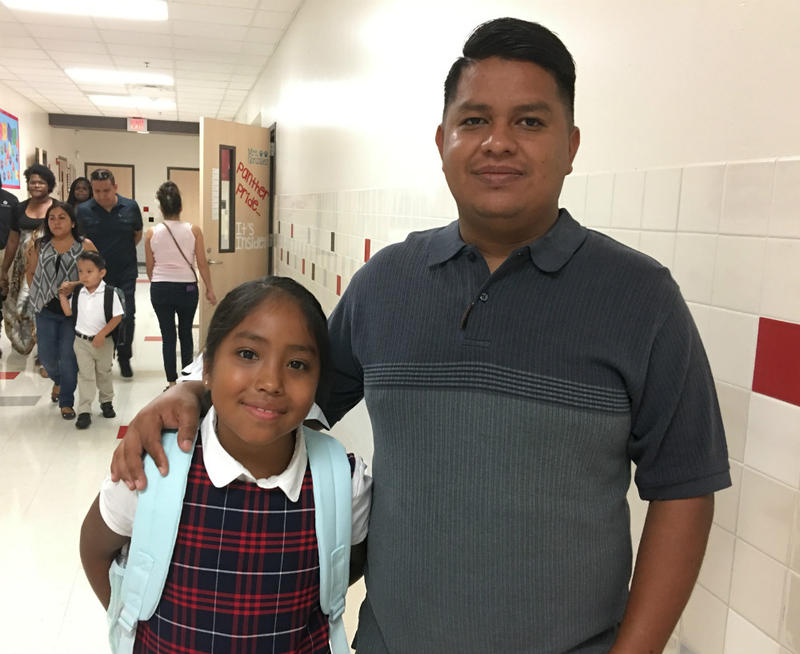 Juan Lira with his daughter, one of two now attending Handley Elementary.