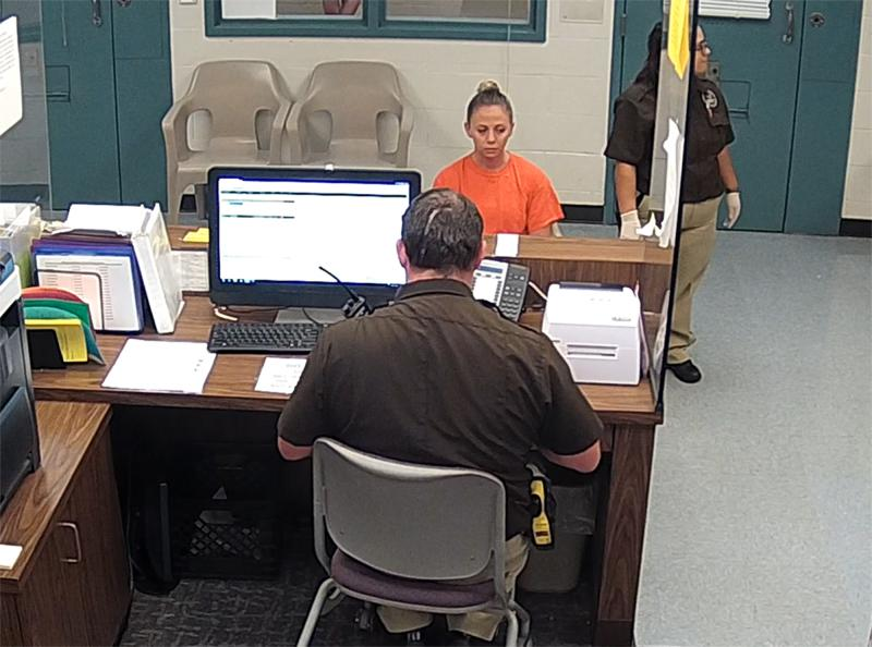 This photo from video released Sept. 13, 2018, by the Kaufman County Sheriff's Office, shows Dallas police Officer Amber Guyger getting booked after turning herself in Sunday, Sept. 9 following the fatal shooting of Botham Jean.