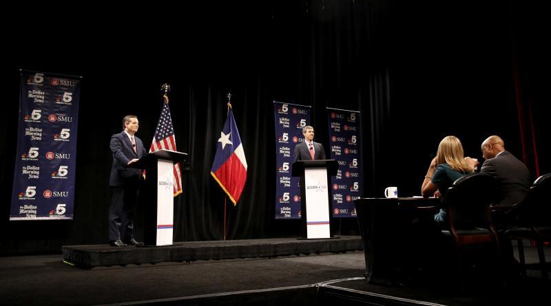 Republican U.S. Senator Ted Cruz, left, and Democratic U.S. Representative Beto O'Rourke, second from left, take part in their first debate for the Texas U.S. Senate in Dallas, Friday.