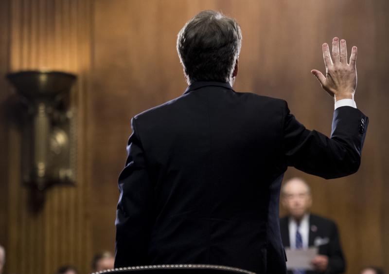 Brett Kavanaugh takes the oath before testifying on Thursday.