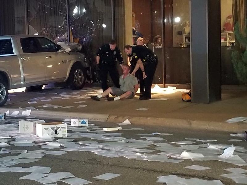 In this image taken from video by KDFW Fox 4 a man is detained after crashing his pickup truck into the side of the Fox affiliate television station building in downtown Dallas on Wednesday. Despite the crash, nobody was hurt.