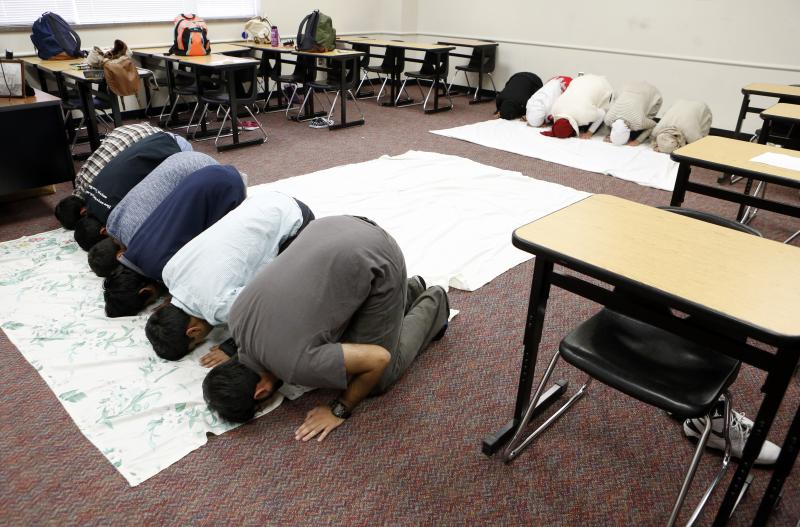 Muslim students gather to pray inside a classroom at Liberty High. Their story earned KERA's Stella Chavez a national award from the Religion News Association.