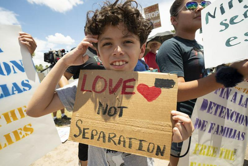 Santiago Martinez Alvarez joins his family in protesting family-separation policies during a vigil outside the Ursula Border Patrol Processing Center in McAllen, Texas on June 17, 2018.
