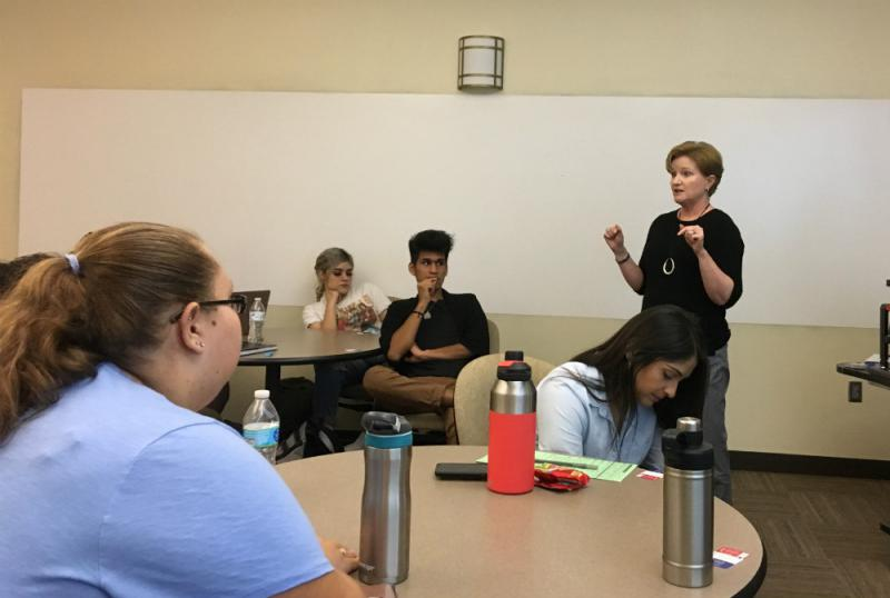 Karen Bassett, with the League of Women Voters, urges students at Eastfield College to register and vote.  Turnout in Texas of young voters is extremely low in a state with the lowest overall turnout in the nation.