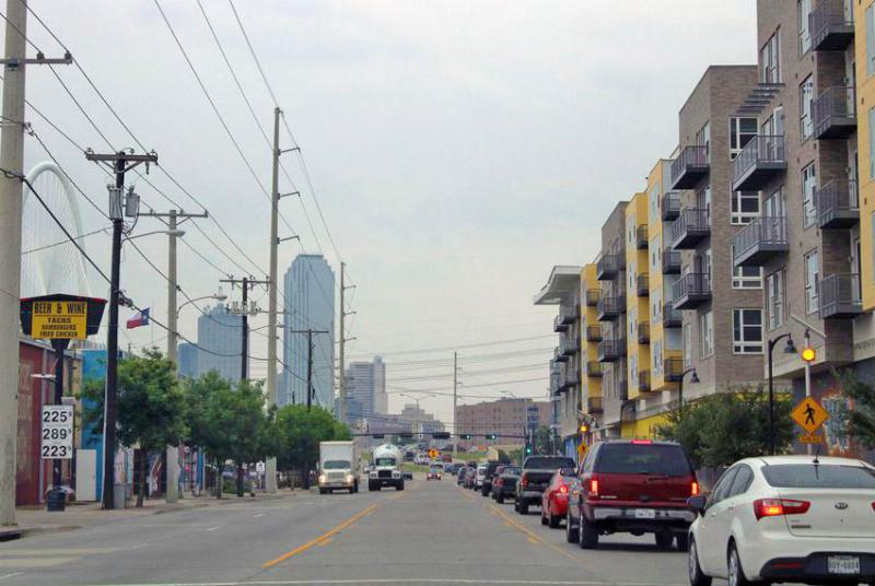 Afternoon traffic headed out of West Dallas and toward downtown backs up on Singleton Boulevard. This Dallas neighborhood is changing fast as new apartments and restaurants replace aging homes and businesses.