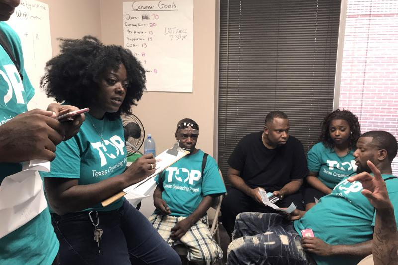 Shetamia Taylor briefs her team of 14 canvassers before they go engage voters for the Texas Organizing Project.