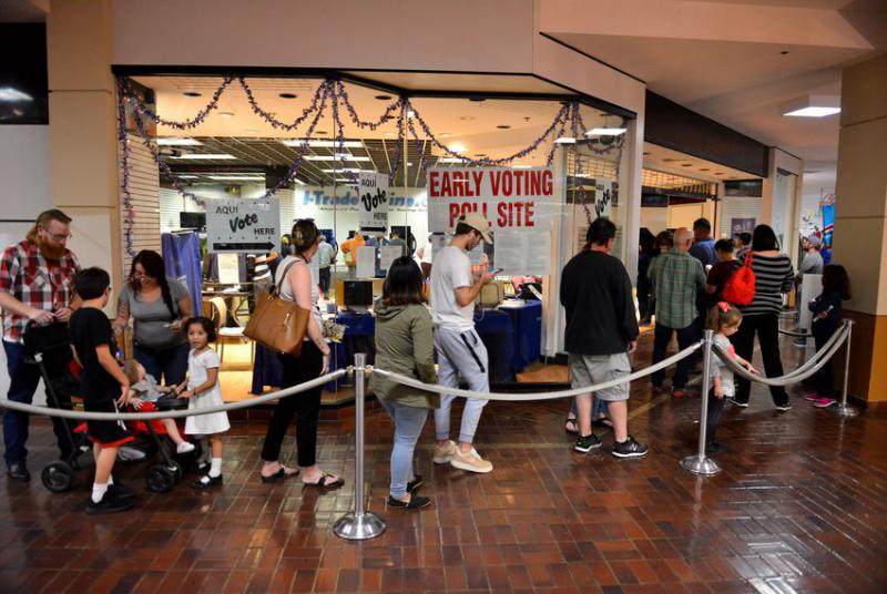 Voters wait to cast their ballots at the Wonderland of the Americas Mall in San Antonio late Friday afternoon, the last day of early voting.