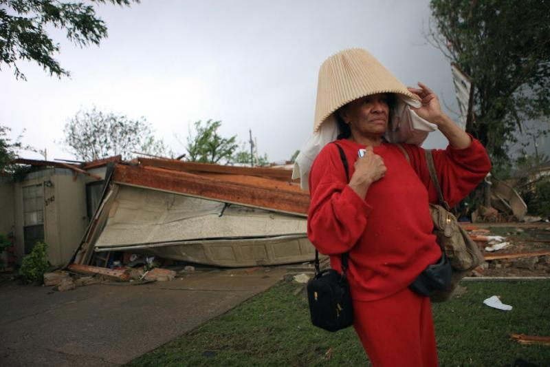 Mary hid in a closet when the twister came through Lancaster. A portion of her roof is gone and a few walls came down but she made it out.