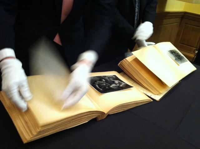 Albums 7, left, and 15, right, are shown to patrons at SMU's Meadows Museum Tuesday.