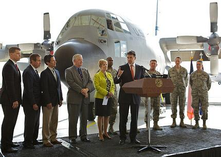 Governor Rick Perry is shown at Fort Worth's C-130 hangars in April.