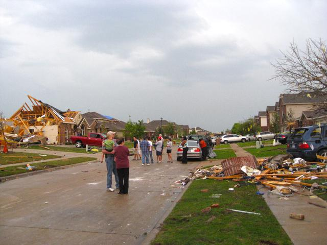Neighbors assessing damage after the Tornado struck in Forney.