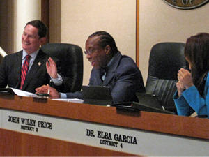 Dallas County Judge Clay Jenkins, left, and Commissioner John Wiley Price, center, are pictured in a meeting earlier this year.