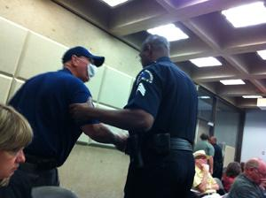 Gas drilling protester escorted from City Council briefing.