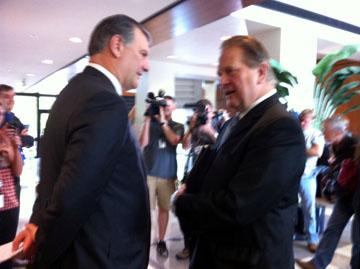 Arlington Mayor Robert Cluck, right, talks with Dallas Mayor Mike Rawlins about an arrest made in murder for hire plot.
